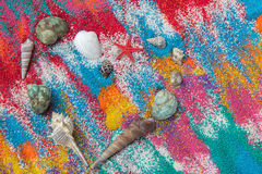 Beautiful heart background on colored sand made from sea shells Stock Photos