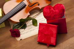 Beautiful heart in box, rose and violin! Stock Photos