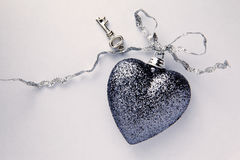 Beautiful Heart With Key On Silver Ribbon stock photography