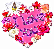 Beautiful heart with legend made of different flowers Stock Images