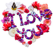 Beautiful heart with legend made of different flowers Royalty Free Stock Photography
