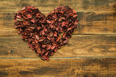 Beautiful heart maked with dry petals Royalty Free Stock Photo