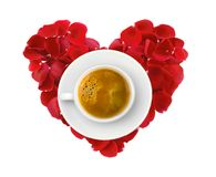 Beautiful heart of red rose petals and cup of coffee isolated on Stock Image