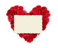 Beautiful heart of red rose petals and greeting card isolated Stock Image