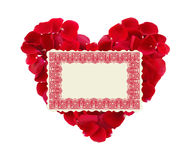 Beautiful heart of red rose petals and greeting card isolated Stock Photography