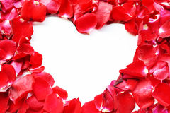 Beautiful heart of red rose petals isolated on white Stock Photo
