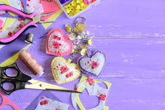 Beautiful hearts and flowers keyring. Homemade felt and fabric keyring or bag charm. Organizer with plastic flowers, scissors Royalty Free Stock Images