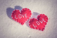 Beautiful hearts on a snow backgroud Royalty Free Stock Image
