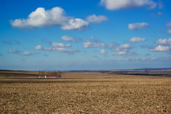 Beautiful heavenly landscape over farm fields in early spring Stock Images