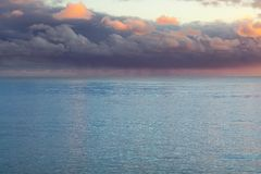 Beautiful heavy purple clouds over the sea stock image
