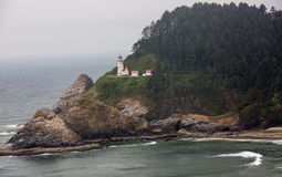Heceta Head Lighthouse sitting high on the Oregon Coast stock image