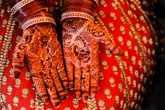 Beautiful Henna and bangles on bride's hands. Stock Images