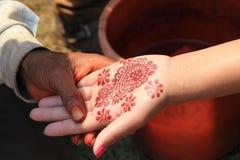 Beautiful henna pattern mehendi on hands stock photos