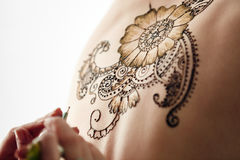 Beautiful henna patterns in process of applying Royalty Free Stock Image