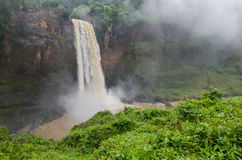 Beautiful hidden Ekom Waterfall deep in the tropical rain forest of Cameroon, Africa Stock Image