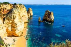 Beautiful hidden sandy beach between rocks with kayaks stock photography