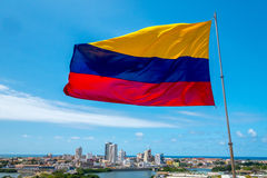 Beautiful high angle view of Cartagena, Colombia. On a sunny morning behind the Colombian flag waving on a pole royalty free stock images
