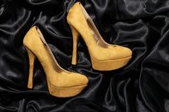 Beautiful high heels on satin Royalty Free Stock Image