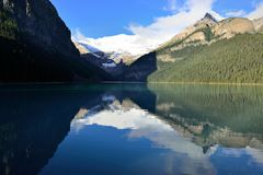 Beautiful high mountains of the Canadian Rockies as seen from Lake Louise reflecting in an alpine lake along the Icefields Parkway royalty free stock photos