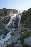 Beautiful powerful mountain waterfall Stock Images