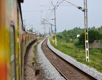 Indian electric train with vacant railway stock photograph. The beautiful high speedy Indian electric train along with the vacant railway unique stock photograph Stock Images