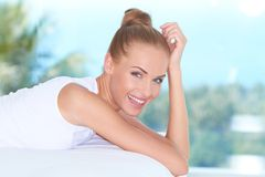 Beautiful high-spirited woman laughing Stock Photo
