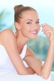 Beautiful high-spirited woman laughing. Closeup facial expression of a beautiful high-spirited woman laughing into the camera Royalty Free Stock Photos