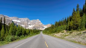 Road Trip in the Rocky Mountains, Canada. Beautiful Highway through Canadian Rockies. Road Trip in the Rocky Mountains, Canada royalty free stock photography