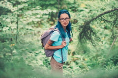 Beautiful hiker girl in summer forest Royalty Free Stock Photos