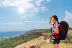 Beautiful hiker hiking to the top of the mountain. Happy to enjoying the beautiful sea scenery and sunny sky copyspace in the summer vacation in the Kenting Stock Photos