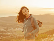 Beautiful hiker young woman with backpack outdoor Stock Image