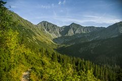 A beautiful hiking trail in the mountains. Mountain landscape in Tatry, Slovakia. Walking path scenery royalty free stock photos