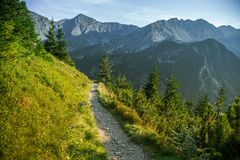 A beautiful hiking trail in the mountains. Mountain landscape in Tatry, Slovakia. Walking path scenery stock image