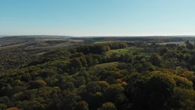Beautiful Hill in the Countryside. River Valley, Autumn Forest, Cloudless Sky stock footage