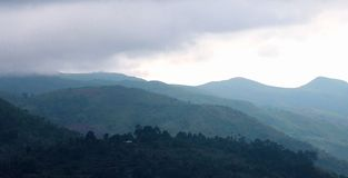 Beautiful hill hillses with mist near the kodaikanal tour place. royalty free stock image