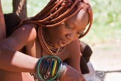 Beautiful Himba woman sewing Stock Photos