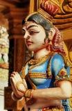 Beautiful hinduist sculpture. Color wood woman beautiful hinduist sculpture Stock Photography