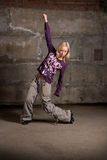 Beautiful hip-hop girl dancing over brick wall Royalty Free Stock Image