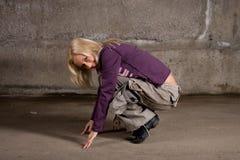 Beautiful hip-hop girl dancing over brick wall Royalty Free Stock Image