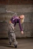 Beautiful hip-hop girl dancing over brick wall Stock Images