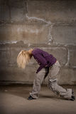 Beautiful hip hop girl dancing over brick wall Royalty Free Stock Photo