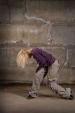 Beautiful hip hop girl dancing over brick wall Royalty Free Stock Photo