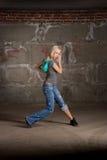 Beautiful hip hop girl dancing over brick wall Royalty Free Stock Photography