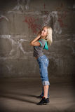 Beautiful hip hop girl dancing over brick wall Stock Photo