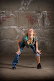 Beautiful hip hop girl dancing over brick wall Stock Photography