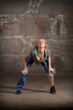 Beautiful hip hop girl dancing over brick wall Stock Photography