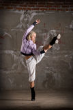Beautiful hip hop girl dancing over brick wall Stock Photos