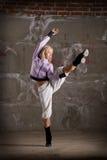 Beautiful hip hop girl dancing over brick wall Stock Photos