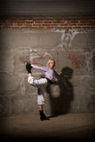 Beautiful hip hop girl dancing over brick wall Royalty Free Stock Images