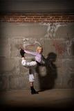 Beautiful hip hop girl dancing over brick wall Royalty Free Stock Images